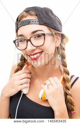 a teenager girl with headhpones on white