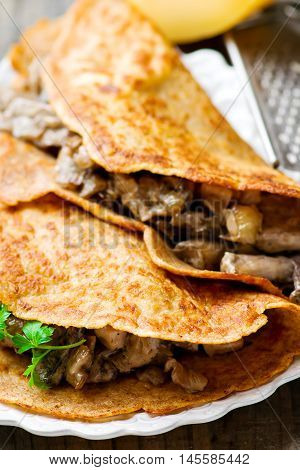 Buckweat crepes with mushroom . selective focus