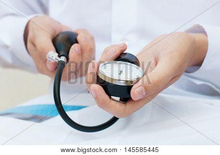 Blood pressure gauge in a doctor's hands