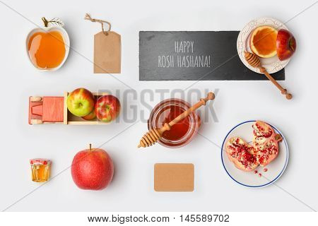 Jewish holiday Rosh Hashana mock up template with honey jarapples and pomegranate. View from above. Flat lay