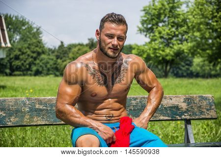 Muscular Handsome Shirtless Hunk Man Outdoor in City Park. Showing Healthy Muscle Body