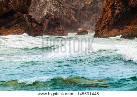 Isolated beach Ursa on Atlantic coast near the Cape Roca, Sintra, Portugal
