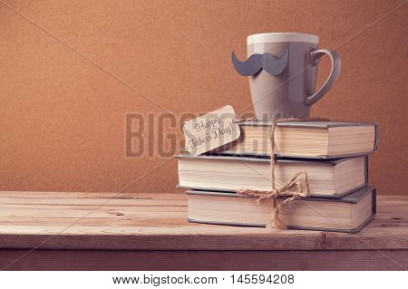 Cup of tea and old books for Father's Day celebration