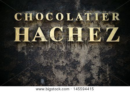 BREMEN, GERMANY - AUGUST 30: The golden nameplate of the Chocolate Factory Hachez & Co on a soot-blackened house facade on August 30, 2016 in Bremen.