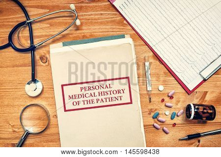 Personal medical history of the patient healthcare concept with doctor's worskpace top view