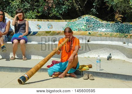 BARCELONA, SPAIN - MAY 06, 2005: Street musician play at Parc Guell in Barcelona