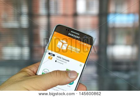 MONTREAL CANADA - August 8 2016 - AWS mobile app on screen of Samsung S7 in hand. Amazon AWS offers a suite of cloud-computing services that make up an on-demand computing platform