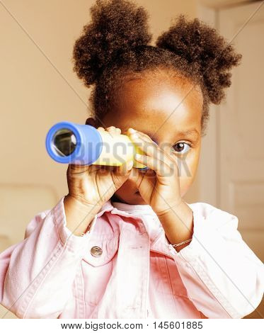 little cute sweet african-american girl playing happy with toys at home, lifestyle children concept close up