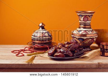 Dried date palm tree fruits on a plate