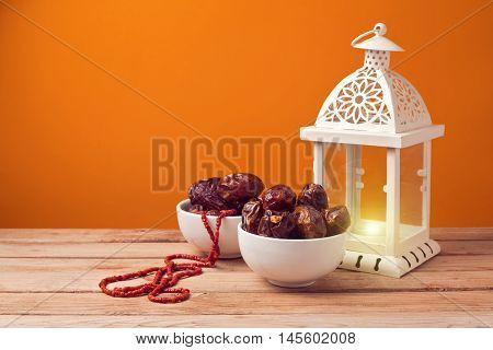 Dried date palm tree fruits with lantern