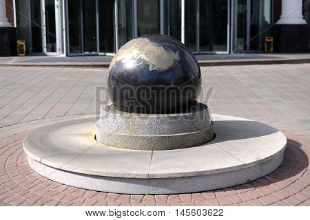 Granite ball mounted on a stand in the town square