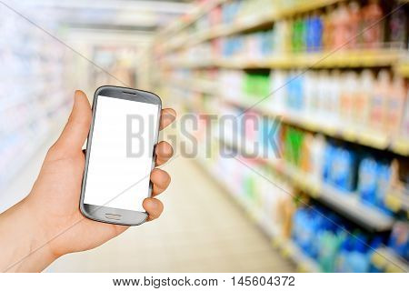Hand holding smartphone in a market mall or department store