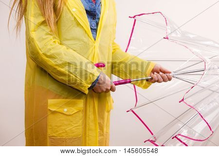 Woman Wearing Waterproof Coat Opening Umbrella
