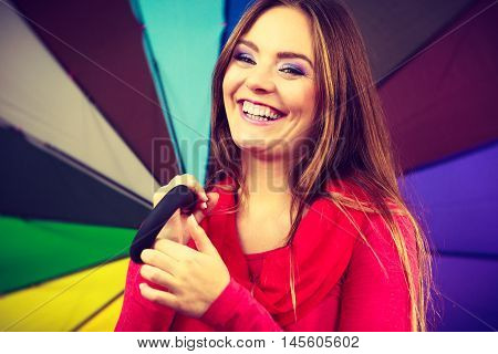 Woman Standing Under Multicolored Umbrella