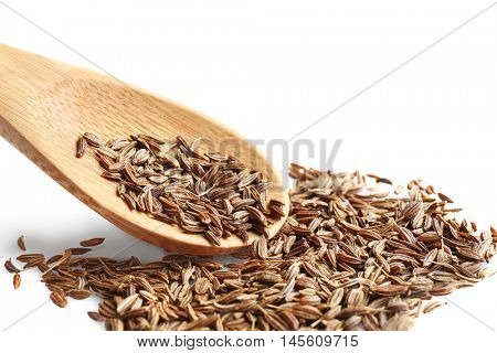 Cumin seeds and wooden spoon on white background
