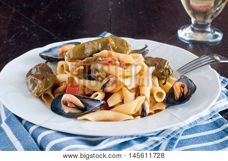 Garganelli typical Italian pasta of the Veneto with mussels tomato and friggitellifood