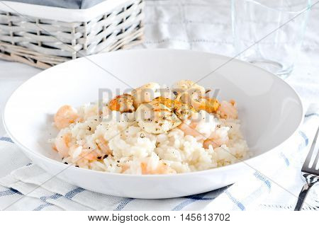 Delicious risotto with shrimp and scallops italy
