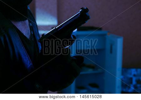 Thief with gun in room