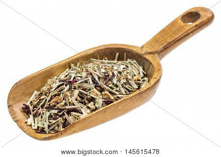 lemon grass herbal tea on a rustic wooden scoop, isolated on white