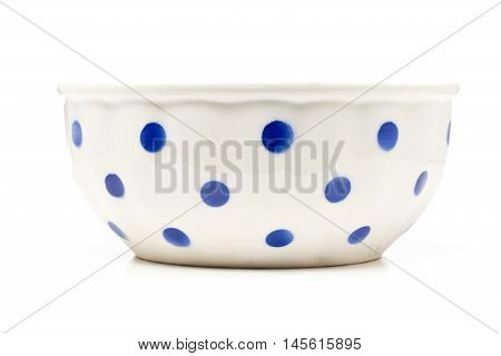 White with blue dots ceramic bowl over white background