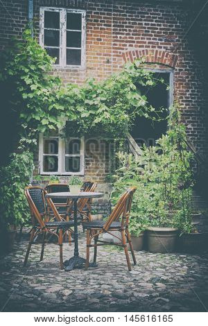 Cozy French Cafe terrace In Old Small European City, Vintage Look