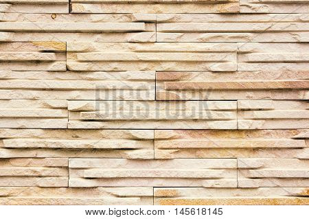 Background of brown stone texture modern wall.