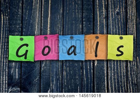 Goals message post on wooden wall close-up