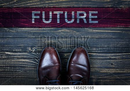 Future message and business shoes on wooden floor