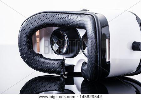 Virtual Reality Goggles On Shiny Surface