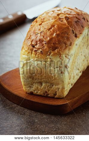 Organic flax bread with seeds on a kitchen board. Healthy and natural food.