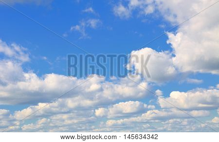 Clouds in the blue sky on day .