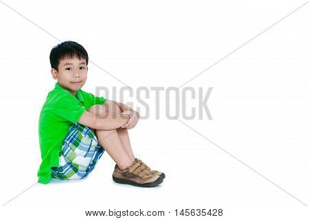 Side View Of Asian Child Smiling And Looking At Camera. Isolated On White Background.