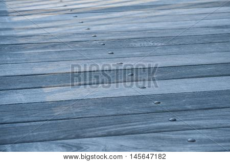Blue wooden boards floor closeup as background