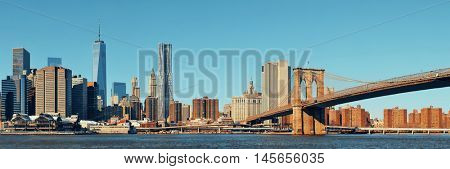 Manhattan financial district with skyscrapers and Brooklyn Bridge.