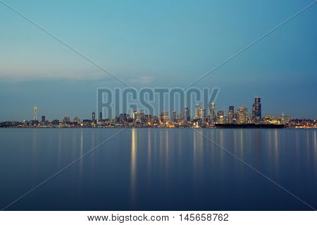 Seattle city skyline view over sea with urban architecture and pebble.