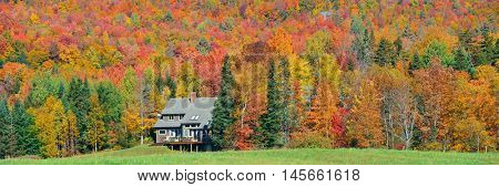 Farm house in countryside view of Stowe with Autumn mountains and forest