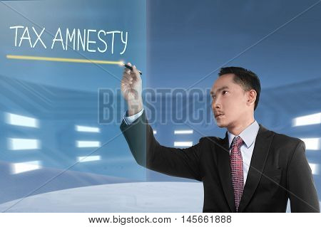 Business Man Writing Tax Amnesty Words