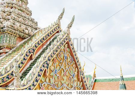 Close Up Thai Temple With Ornament Art Roof Top At Blue Sky,bangkok Thailand