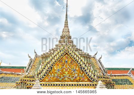 Thai Temple With Ornament Art Roof Top At Blue Sky,bangkok Thailand