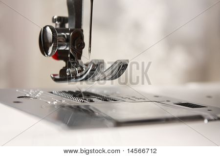 Shuttle close-up of a needle in a sewing machine