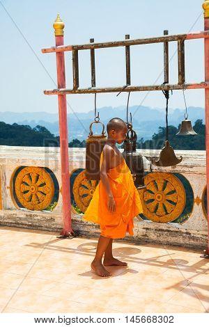 KRABI THAILAND - APRIL 10: Novice monk observe the hilltop of the Tiger Cave Mountain Temple on April 10 2016 in Krabi Thailand.