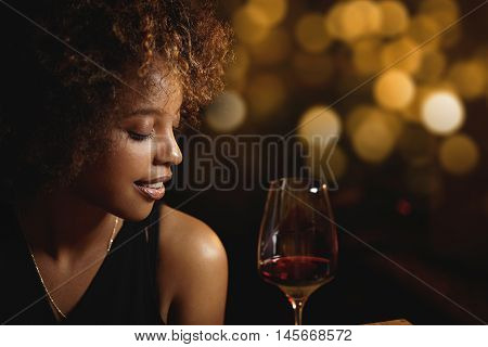 Profile Of Dark-skinned Luxurious Woman With Afro Haircut Wearing Elegant Evening Dress Drinking Red