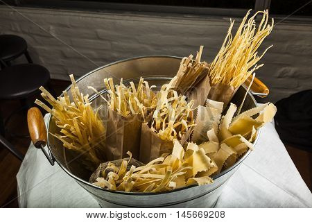 Various types of pasta on a metal tub
