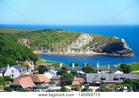 LULWORTH COVE, UNITED KINGDOM - JULY 19, 2016 - View looking down the hillside towards the cove and village Lulworth Cove Dorset England UK Western Europe, July 19, 2016.