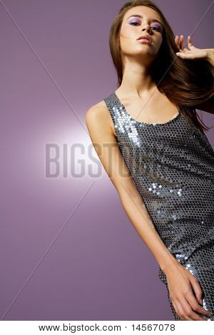 Beautiful young woman wearing fashion dress