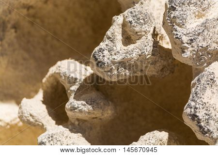 Textured limestone rock with erosion sponge surface Provence France