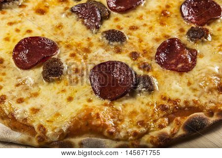 Pizza with salami and pineapple and chees