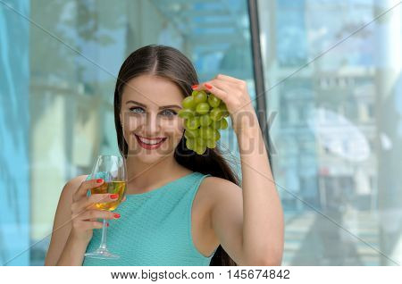 Girl Holding A Glass Full Of White Wine In Her Right Hand
