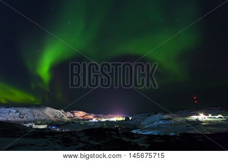 Aurora borealis Green on Teriberka in Murmansk region Russia
