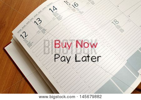 Buy now pay later text concept write on notebook